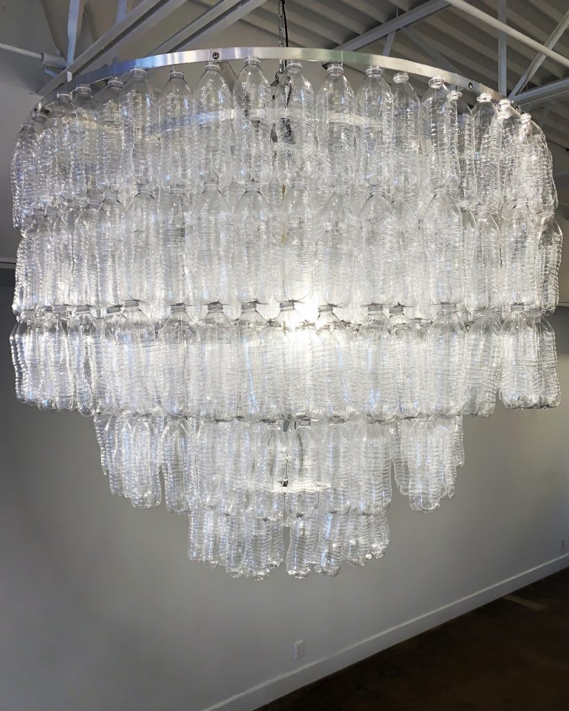 chandelier made from found plastic bottles on the beach by shelia rogers | Felder Gallery